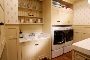 Fehrenbachr cabinets, laundry, laundry room, painted cabinets, custom, folding area, front loading washer, washer dryer, storage, sink